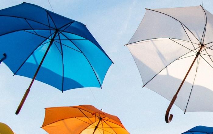 Umbrellas in the sky. Illustrating umbrella companies.
