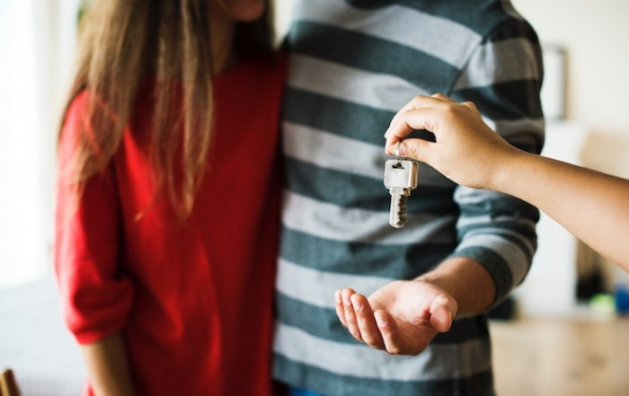 Couple getting keys for new house.