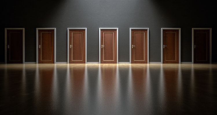 Doors in a dark room, visualising contractors choices.