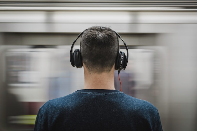 Contractor listening to podcast on headphones.