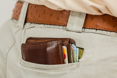 Wallet showing in pocket.