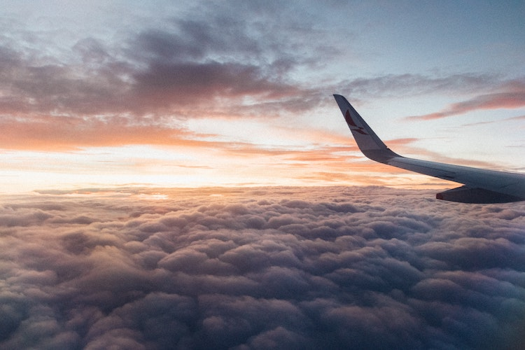 Aeroplane wing above the clouds.