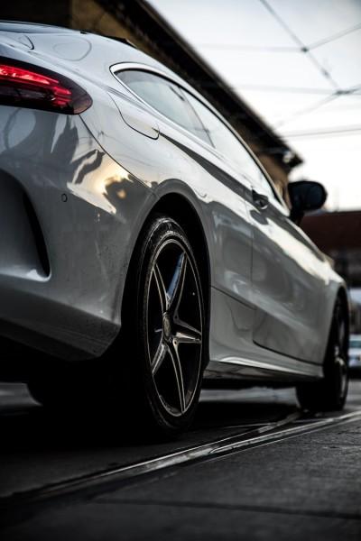 Focus on car wheel.